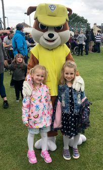 Photo of two children with a Paw Patrol character.