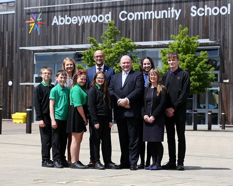 Photo of Mayor Tim Bowles with a group of students and teachers outside Abbeywood Community School.