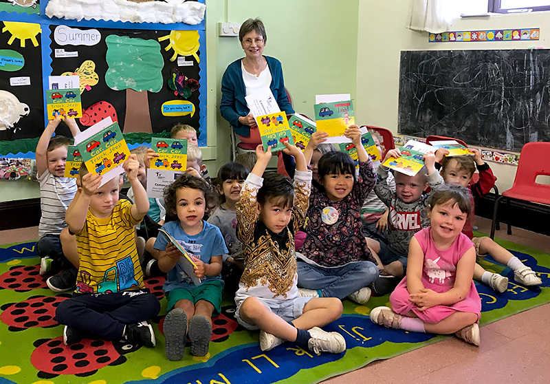 Photo of a Bookstart Pyjamarama event taking place at Abacus Pre-School, led by a volunteer from Stoke Gifford Community Library.