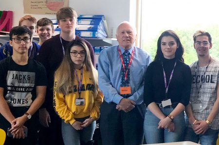 Photo of Lord Rooker with students at Abbeywood Community School.
