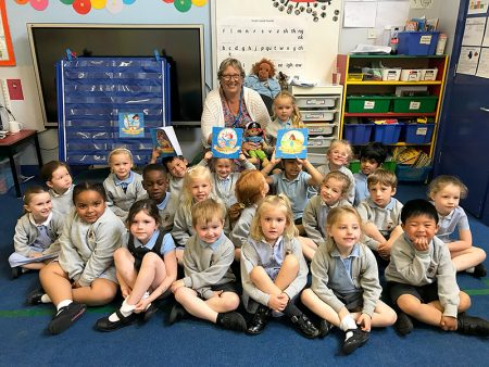 Photo of author Ali Smith with some of the Reception class children.