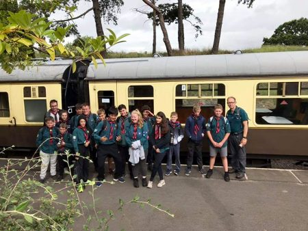 Photo of Scouts embarking on a trip to Gloucester by steam train.