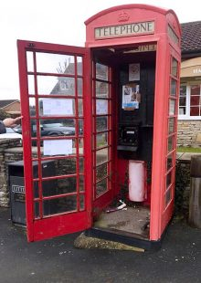 Photo of a disused red telephone box on North Road.