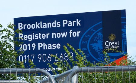 Photo of a sign advertising Crest Nicholson's Brooklands Park housing development.