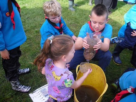 Photo of the Beavers building a water filter in a teamwork exercise.
