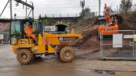 Photo of an excavator preparing the embankment for piling.