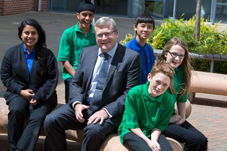 Photo of headteacher Dave Howe with students.