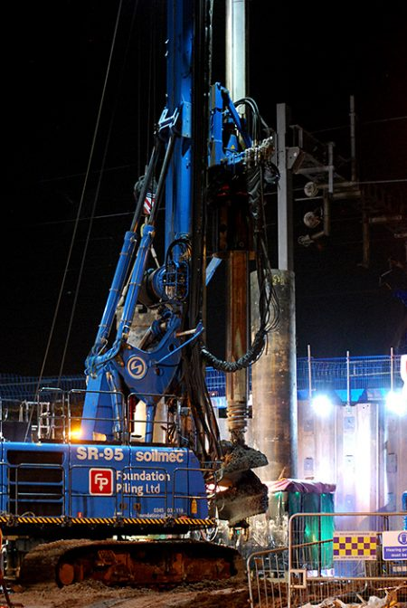 Photo of night-time piling work at the bridge.