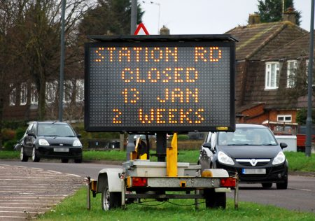 Photo of a road sign informing that Station Road will be closed for two weeks from Monday 13th January 2020.