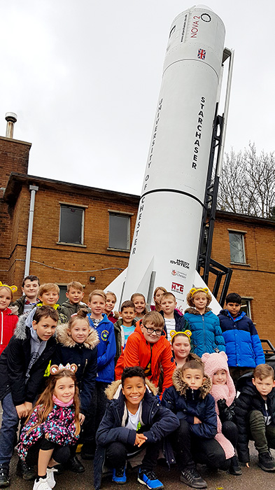 Photo of Year 5 pupils posing in front of the Nova 2 space rocket.