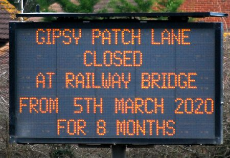 Photo of a dot matrix road sign informing of the closure of Gipsy Patch Lane for 8 months.