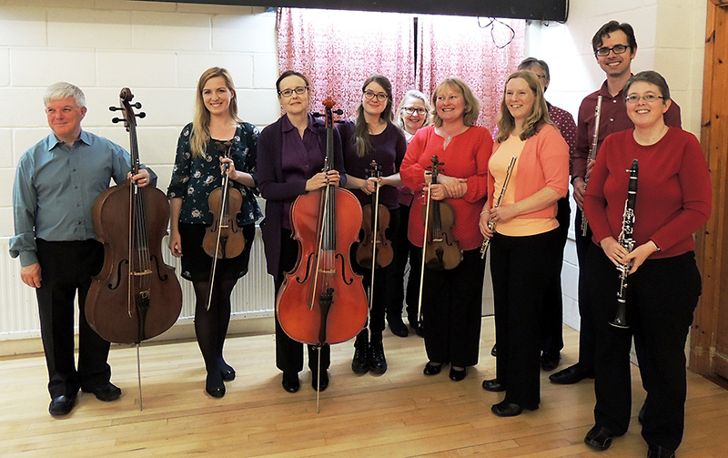Photo of members of The Gifford Ensemble with their instruments.