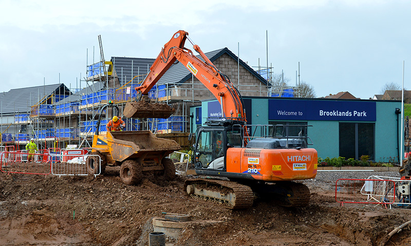Photo of construction activity at Brooklands Park, showing the soon-to-open marketing suite.