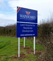Photo of a Wainhomes 'Land acquired' sign'.