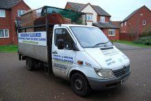 Photo of a rubbish collection vehicle.