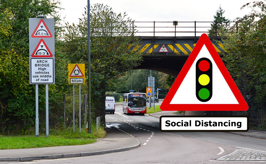 Photo of a traffic lights sign with the text 'social distancing' beneath, superimposed on an image of the railway bridge.