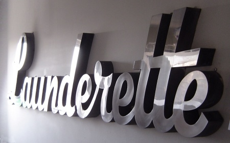 Photo of a launderette sign.