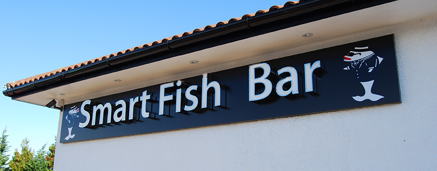 Photo of a sign outside the Smart Fish Bar.