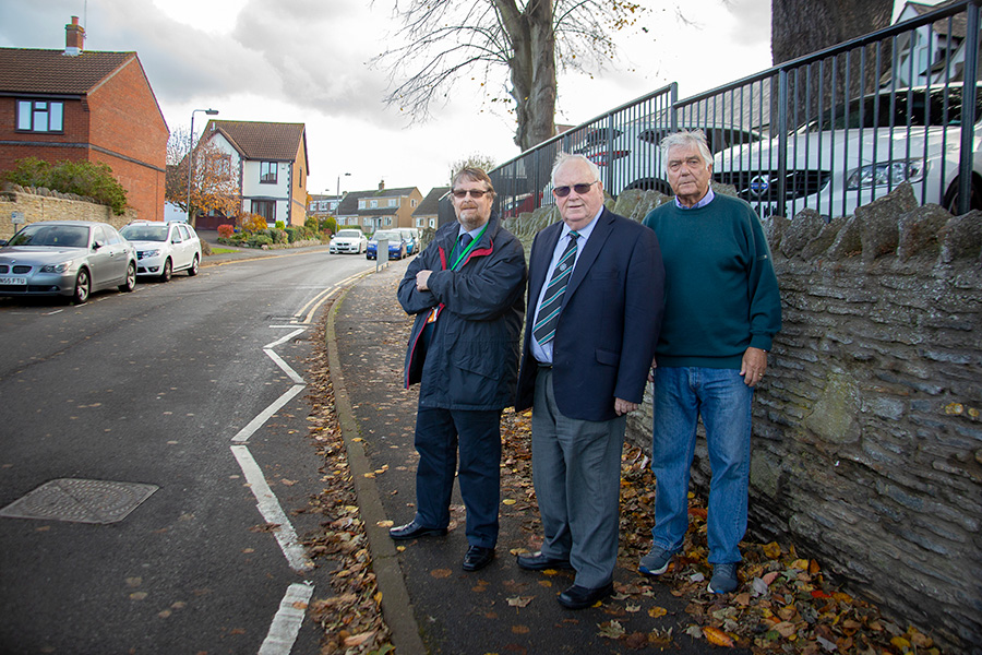 Photo of Stoke Gifford ward councillors (l-r) Keith Cranney, Brian Allinson and Ernie Brown standing on the pavement in North Road.