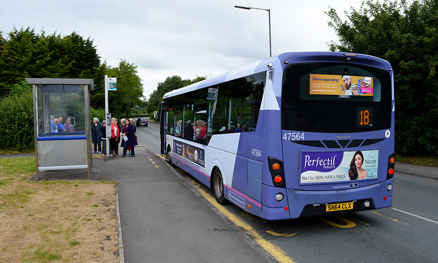 Photo of a bus waiting at a stop on Hatchet Road.