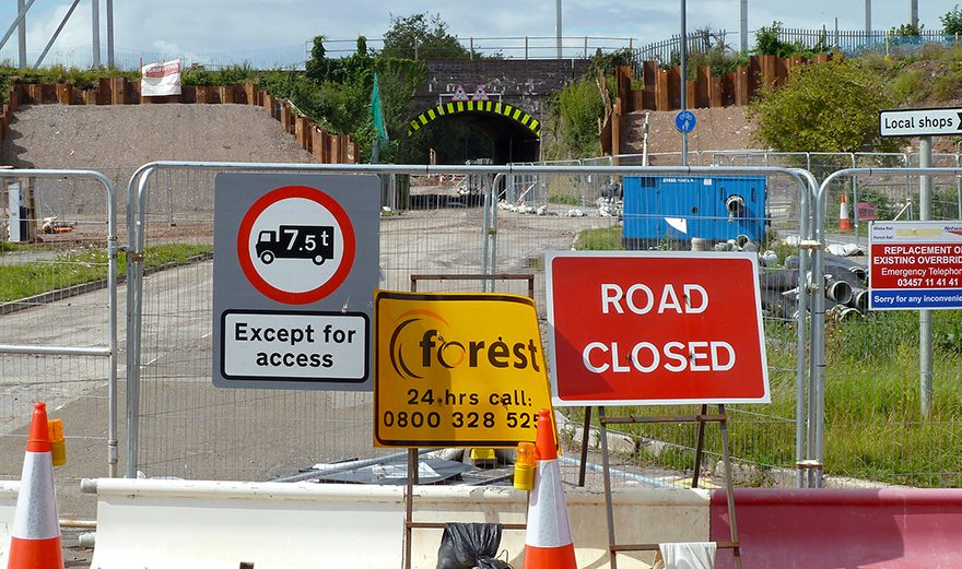 Photo of road closure signs and barriers.