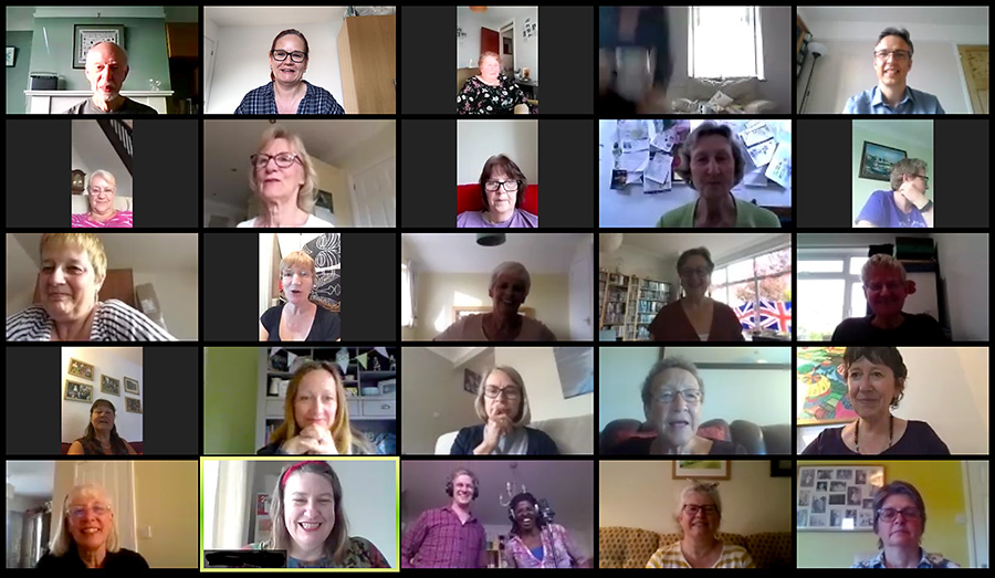 Photo showing several members of the choir rehearsing via the Zoom videoconferencing app.
