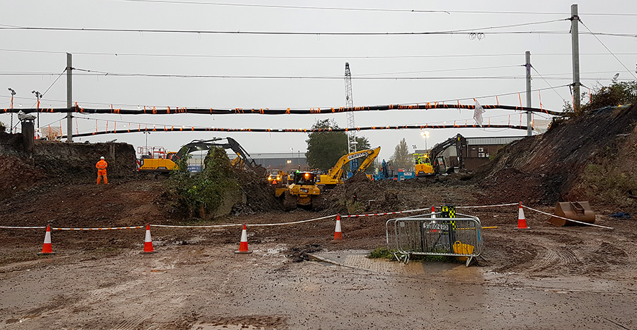 Photo showing bridge site the morning after the old bridge had been demolished.