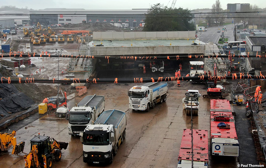 Photo of tarmac being laid underneath the front part of the bridge.
