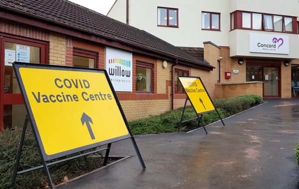 Photo displaying 'Covid Vaccination Centre' outside Concord Medical Centre.
