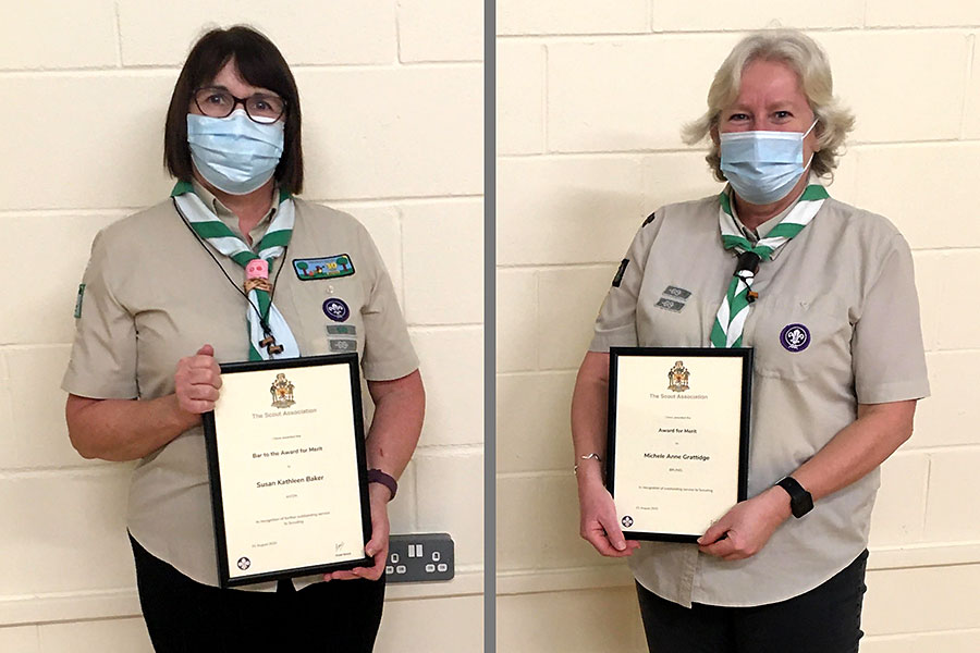 Photo of two Scout leaders holding award certificates.