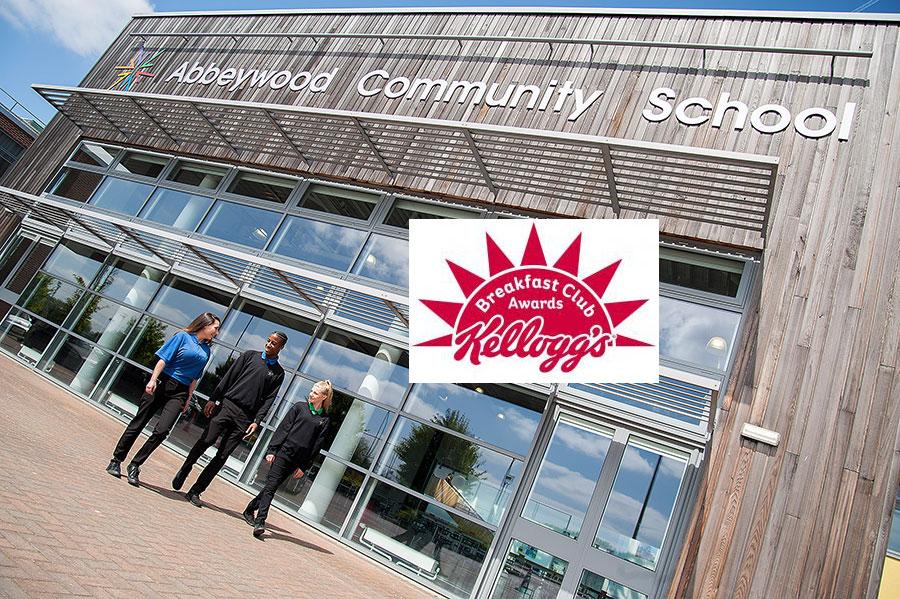 Kellogg's Breakfast Club Awards logo superimposed on a photo of Abbeywood Community School.