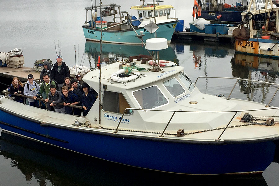 Photo of a boat wit Scouts on deck.