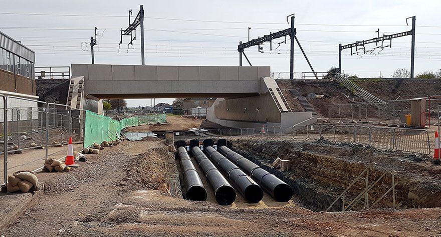 Photo of bridge and huge drainage pipes.