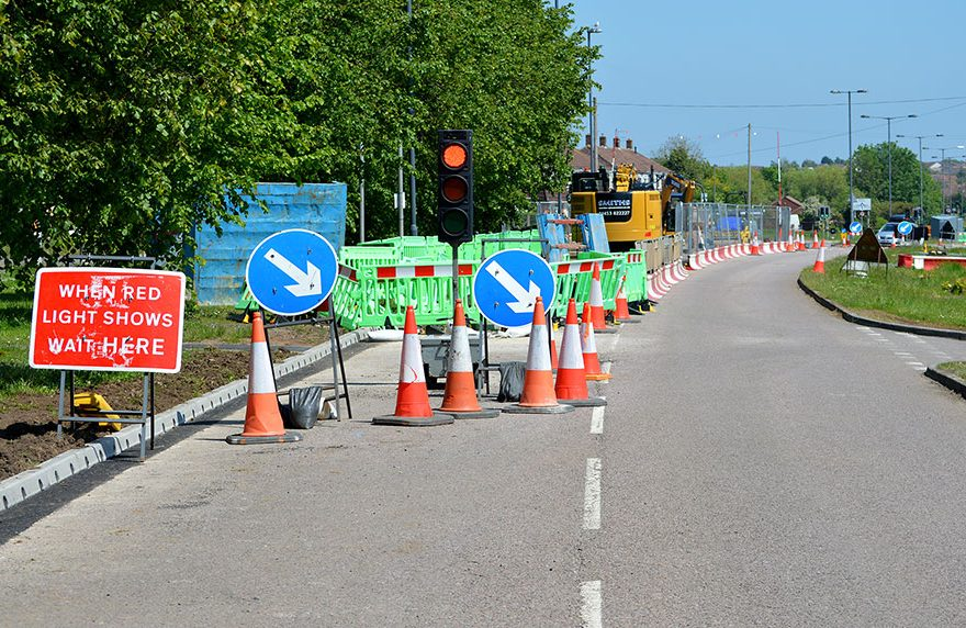 Photo of temporary traffic lights at roadworks.