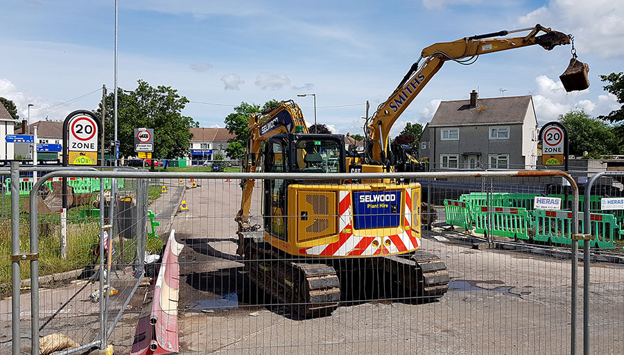Photo of an excavator on a closed road.