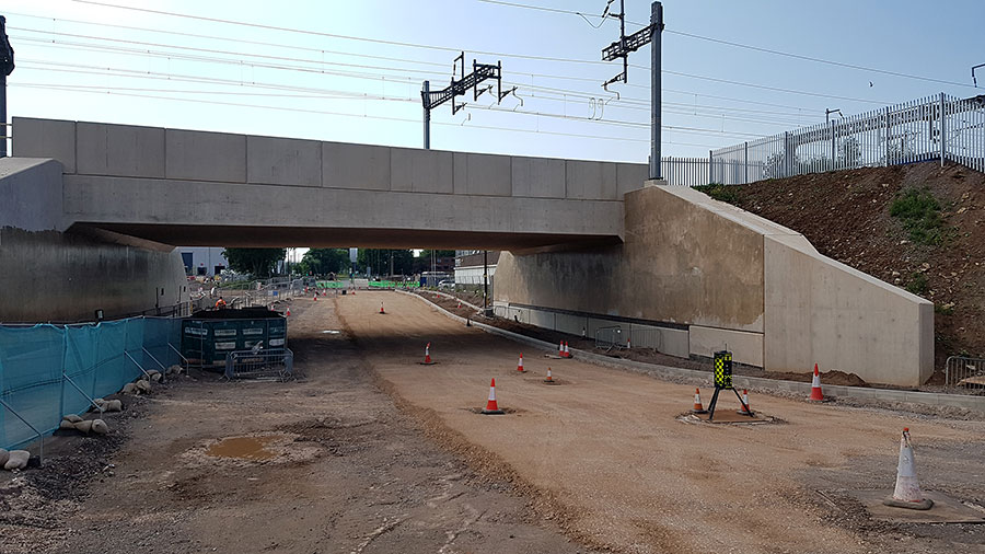 Photo of a railway bridge with partly prepared road surface underneath.