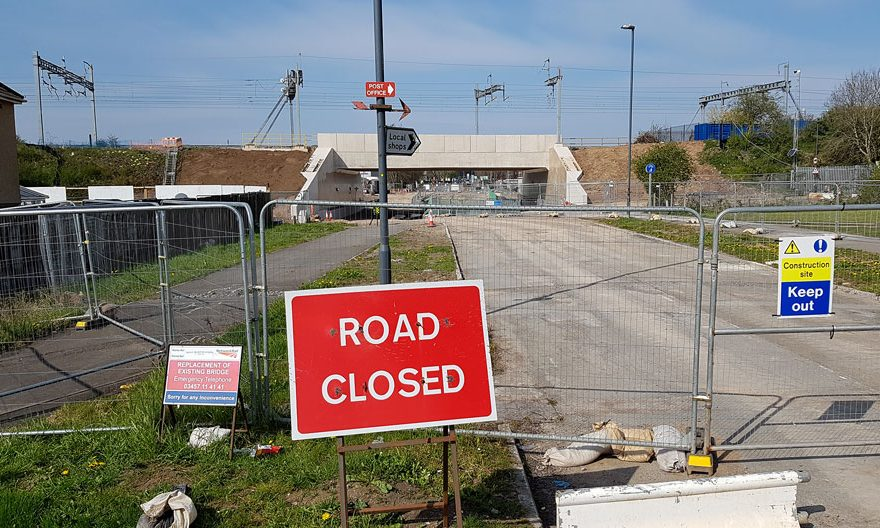 Photo of a 'road closed' sign in front of a bridge.