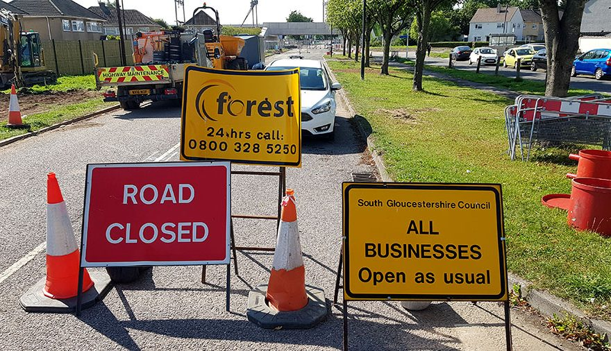 Photo of road closure signs.