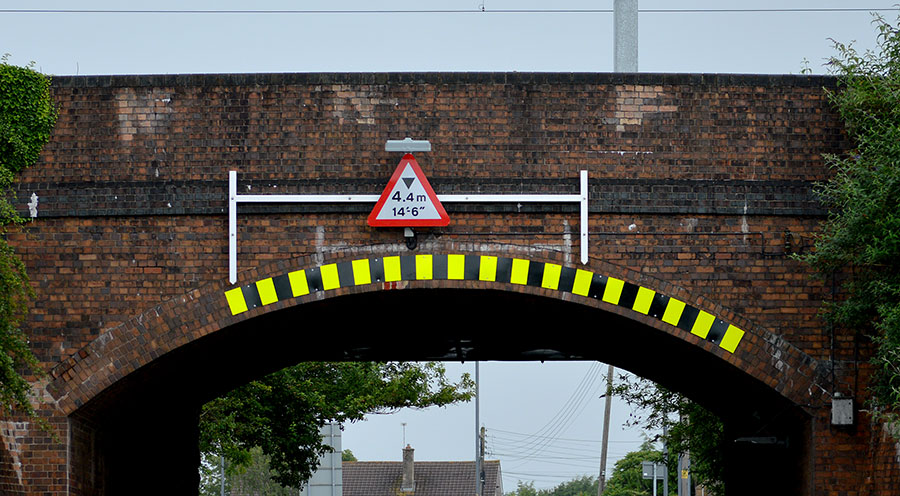 Photo of a bridge with height warning signage.
